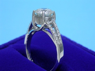 Round Diamond Ring: 1.05 carat in 0.14 tcw Pave Split Shank Trellis mounting