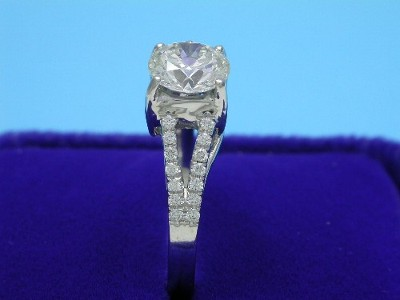 Custom platinum split-shank trellis-style mounting with twenty-eight round bead-set diamonds going half way down the shank