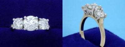 Round Diamond Ring: 1.11 carat with 0.92 tcw Round Side Diamonds in Two-Tone Mounting