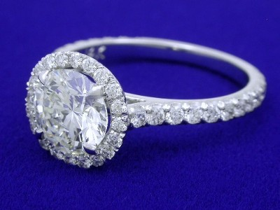 Round Diamond Ring: 1.22 carat in 0.44 tcw Pave Halo and French Cut Pave Shank Mounting