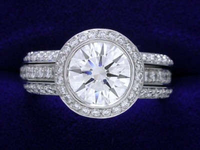 Round Diamond Ring: 1.26 carat in 0.48 tcw Bez Ambar pave mounting with matching bookend style diamond bands