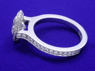 Round diamond engagement ring with Bez Ambar designer knife-edge frame and pave shank