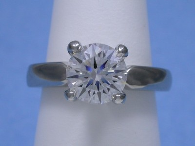 Round diamond engagement ring with Leo Ingwer designer mounting