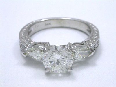 Round and pear cut diamond engagement ring