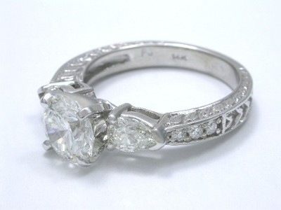 Round Diamond Ring: 1.34 carat in 0.62 tcw Pears and 0.06 tcw Rounds