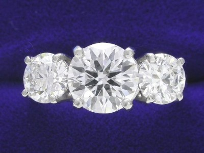 Round Diamond Ring: 1.38 carat Three Stone with 1.07 tcw Round Diamonds