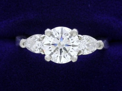 Round Diamond Ring: 1.41 carat with 0.59 tcw Pear Shaped diamonds