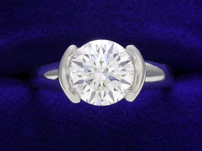Round Diamond Ring: 1.45 carat in Half Bezel style mounting
