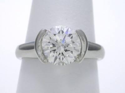 Diamond ring with 1.45 carat round brilliant diamond graded I color, VS2 clarity set in platinum half bezel mounting
