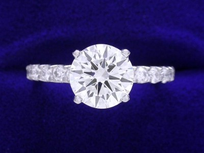 Round Diamond Ring: 1.50 carat with 0.36 tcw Round Diamond Mounting