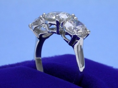Round Diamond Ring: 1.51 carat Three Stone with 2.05 tcw Side Round Diamonds