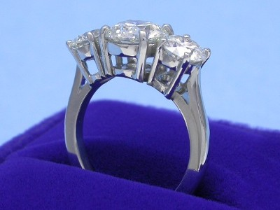 Round brilliant cut three-stone diamond ring