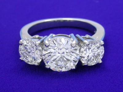 Special Offer: Round cut 1.52 carat I VS2 with 1.19 tcw Round Three-Stone Ring