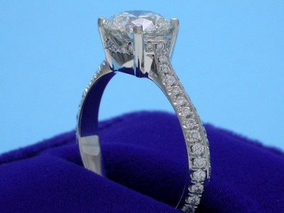 Round Diamond Ring: 1.54 carat with 0.40 tcw pave-set diamonds