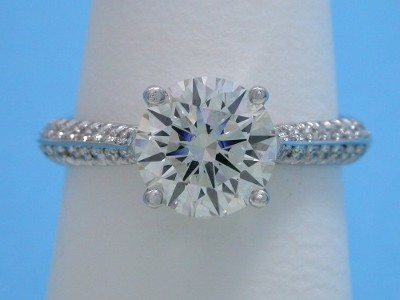 Round diamond engagement ring with platinum pave knife-edge shank