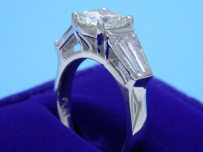 Round Diamond Ring: 1.60 carat with 4 Tapered Baguette Diamonds