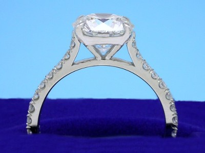 Round brilliant cut diamond engagement ring with modified basket head and pave going down the shank