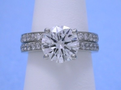 Round Diamond Ring: 1.83 carat with 0.21 tcw Round Brilliant Diamonds and matching diamond band