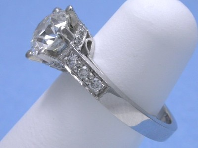 Old European cut diamond engagement ring with bead-set round diamonds on the shank and on the 6-prong basket