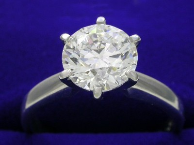 Round brilliant cut solitaire diamond engagement ring with 6-prong platinum head and rounded shank