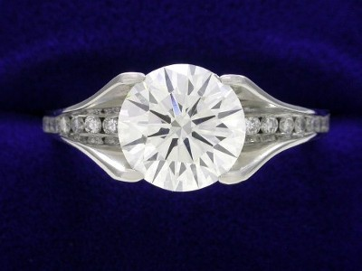 Round Diamond Ring: 2.05 carat in Bez Ambar mounting with 0.30 tcw Channel Set Diamonds
