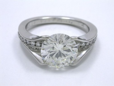 Round brilliant cut diamond engagement ring with Bez Ambar designer platinum mounting and channel set round diamonds