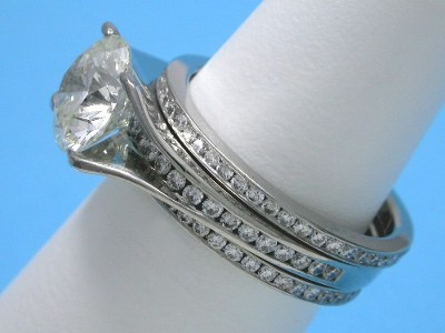Round Diamond Ring: 2.05 carat in Bez Ambar mounting with 0.30 tcw Channel Set Diamonds with Matching Diamond Bands