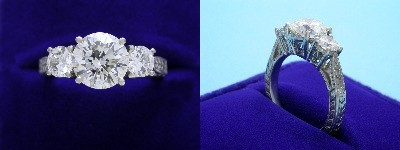 Round Diamond Ring: 2.13 carat Three Stone with 0.72 tcw Round Diamonds