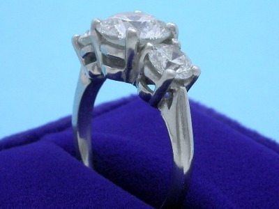 Round Diamond Ring: 2.13 carat with 1.12 tcw Round Diamonds in 3-Stone Mounting