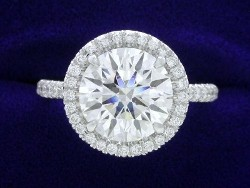 2.51 carat Round Brilliant Cut diamond graded F color and VS2 clarity in platinum 0.32 tcw pave halo and shank mounting