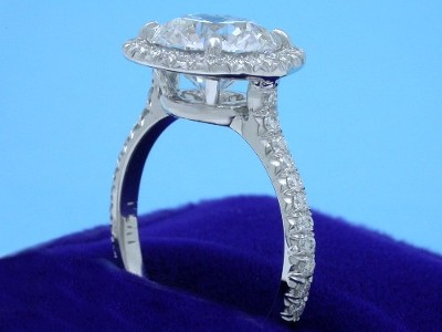 platinum mounting with 4-prong pave halo-style head and French-cut pave shank
