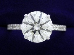 2.56 carat Round Brilliant diamond in Cathedral style mounting with 0.22 total carat weight of pave set diamonds