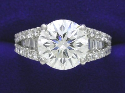 Round Diamond Ring: 2.59 carat with 0.46 tcw Baguettes and 0.46 tcw Round Shared Prong Diamonds
