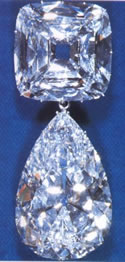 The Cullinan IV (upper, 63.60 carats) and Cullinan III (lower, 94.40 carats), set in a pendant brooch.