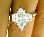 Marquise and trapezoids diamond rings
