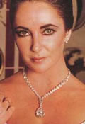 Elizabeth Taylor wearing the Taylor-Burton pear shaped diamond pendant